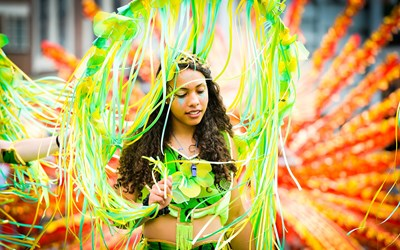 colourful image of lady from Leicester's Caribbean Carnival