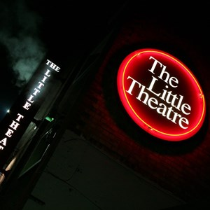 The Little Theatre sign illuminated outside the venue