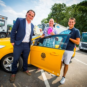 Image: Cllr Clarke, Jeff and Joe Boulton with a council fleet vehicle and Sam Says stickers