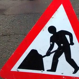Men at work roadsign