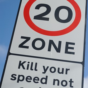 20mph speed limit warning sign in a street