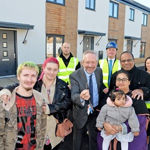 City Mayor Peter Soulsby and residents of Mildand Heart's new affordable homes at Ashton Green
