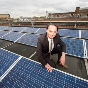 Solar panels on roof with Cllr Clarke