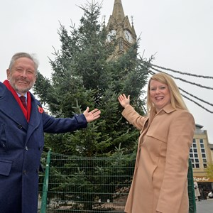 Image: City Mayor Peter Soulsby welcomes the arrival of Leicester's giant Christmas tree with Amy Straszewskyj, Head of HR and Facilities at PPL PRS, which has sponsored Leicester's tree this year.