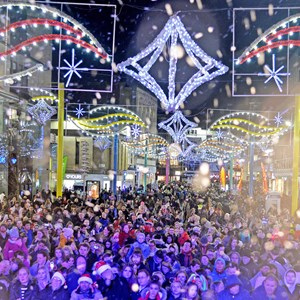 Crowds under the Christmas lights on Humberstone Gate