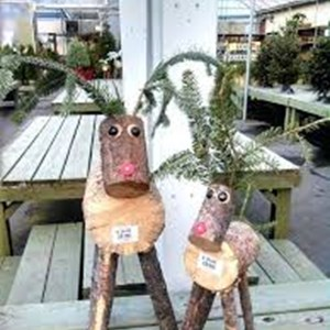 Image: A picture of two reindeer ornaments made from recycled logs
