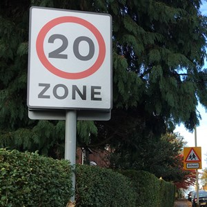 20mph zone signpost on street