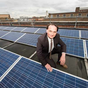 Cllr Adam Clarke with solar panels