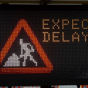 Sign warning of traffic delays