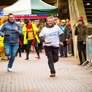 Image: Participants in the 2018 pancake race at Leicester Market