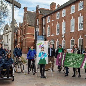 Image: The Greyfriars Open Streets event for April will have a Suffragette theme. Picture shows the Greyfriars area with council staff and partners posing with bikes and Suffragette banners.