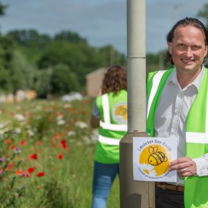 Cllr Adam Clarke with the wildflower-filled Bee Roads