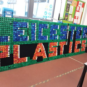 Image: A scoreboard saying 'Leicester 1 Plastics 0' made out of plastic bottle tops by Ellesmere College students