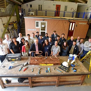 Image shows staff, apprentices, city mayor Peter Soulsby and Cllr Elly Cutkelvin at the city council's construction training centre