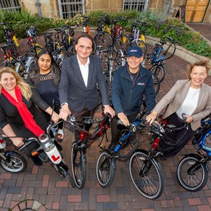Picture shows Cllr Sarah Russell, Paru Bechar, Cllr Adam Clarke, Gary Orton and Hannah May with the fleet of bikes and scooters