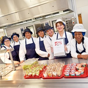 Image: Picture shows catering staff at Wolsey House Primary School with the Food for Life silver award