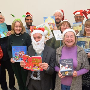 Leicester Libraries staff pictured with some good Christmas reads