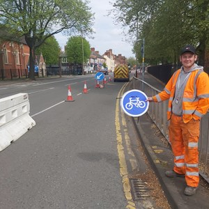 City council highways staff holding cycle sign at new cycle track