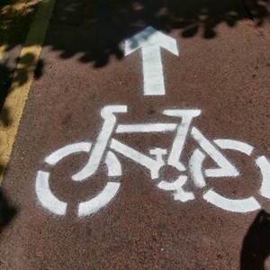 An image of a bike and arrow stencilled onto Road in Leicester to signify a temporary bike lane